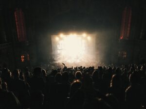 audience in front of lit up stage