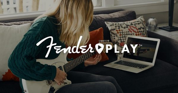 fender play logo over girl with white guitar