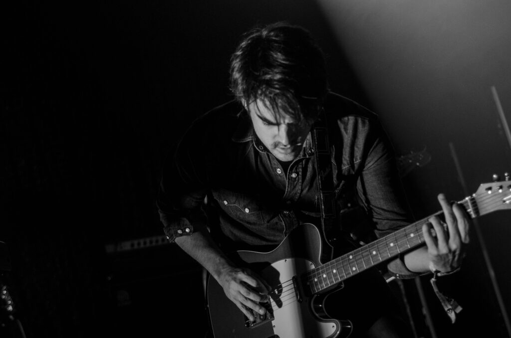 black and white electric guitarist