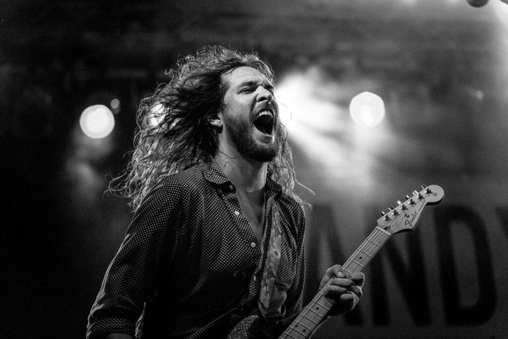headbanger playing electric guitar onstage