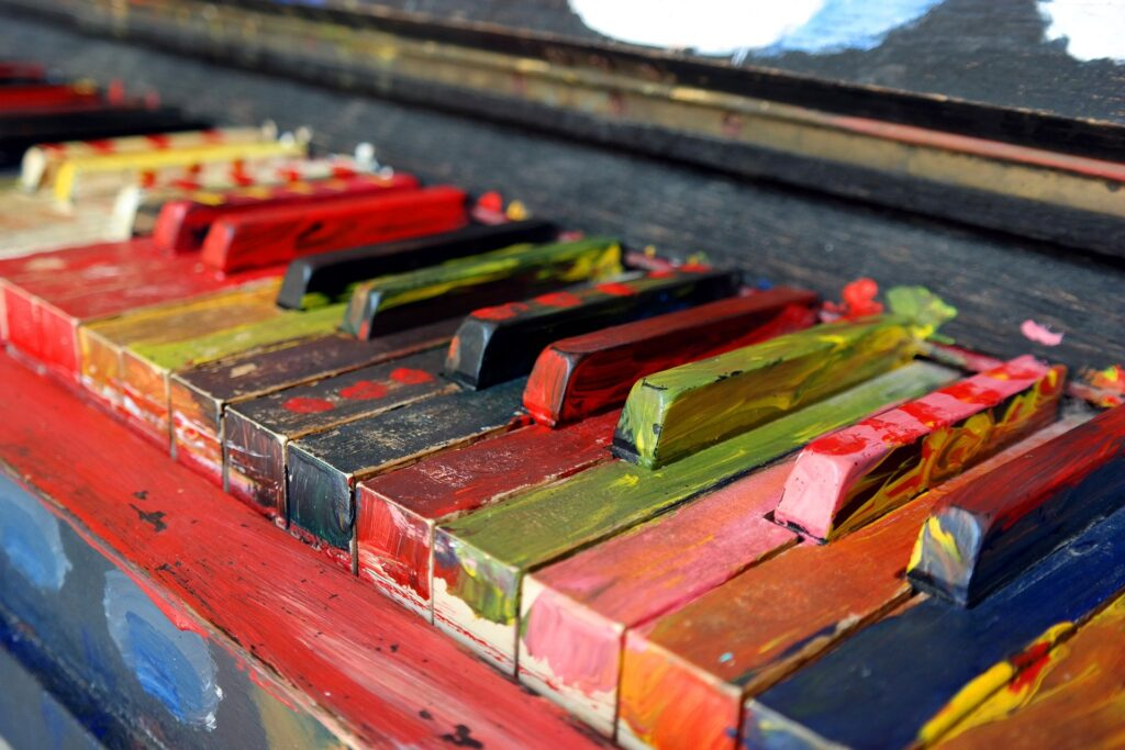 colorful oil painted keys on piano