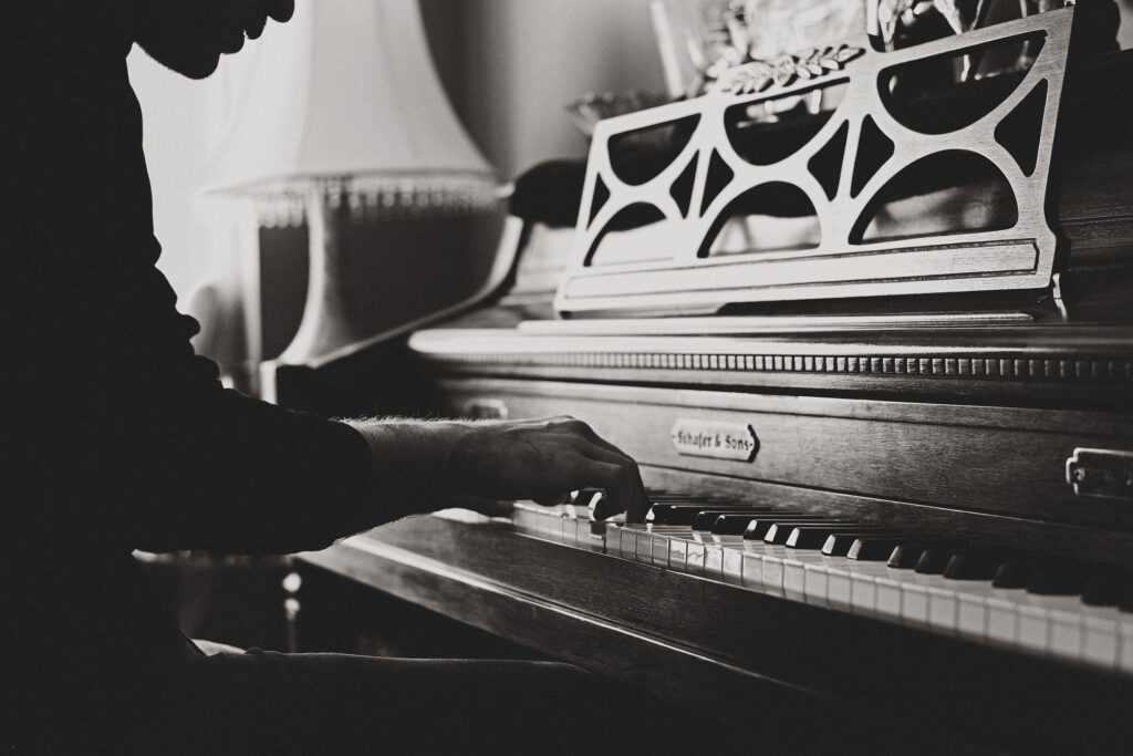 black and white piano player