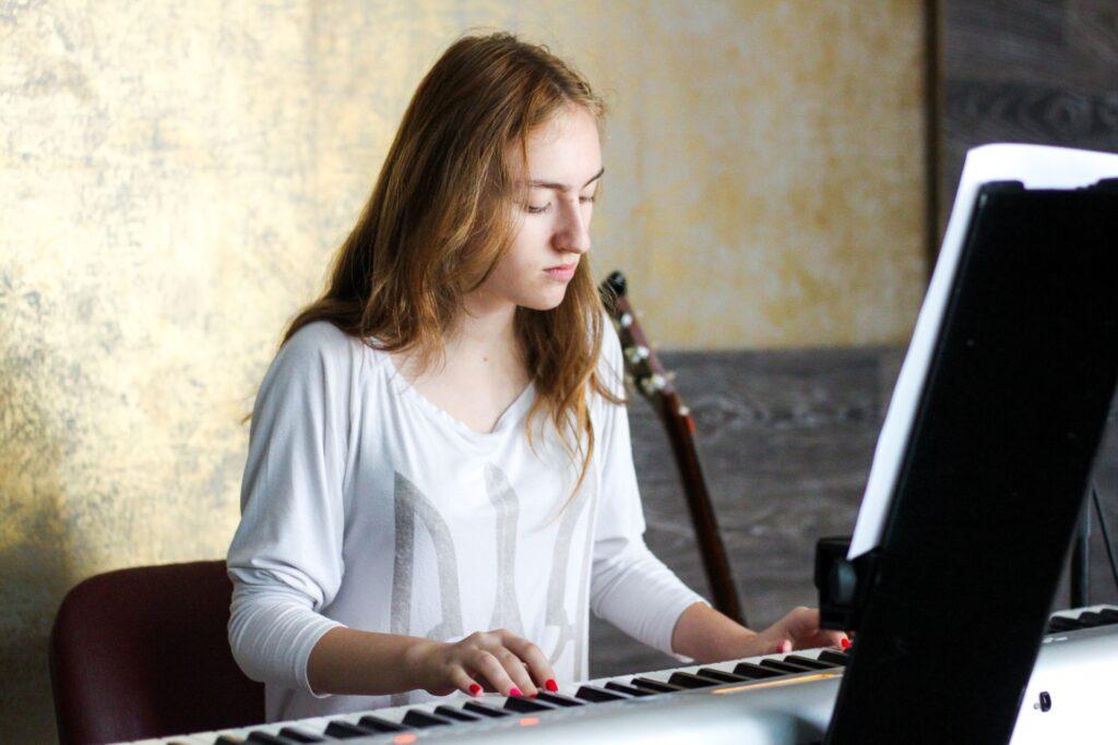 Girl playing white keyboard