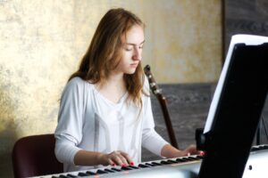 Girl playing white keyboard