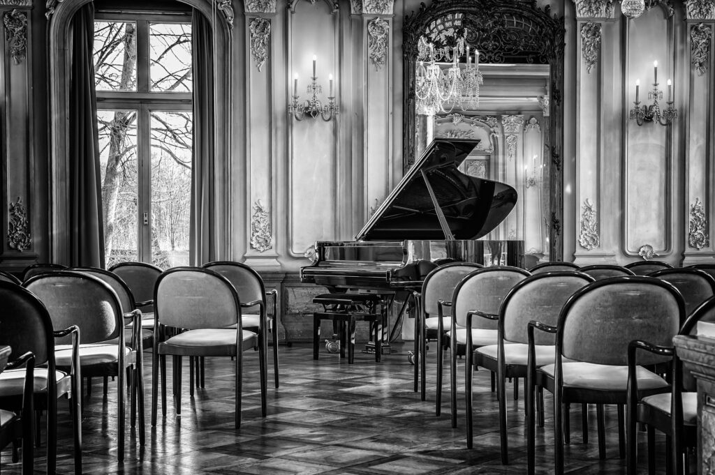 black and white intimate piano concert room