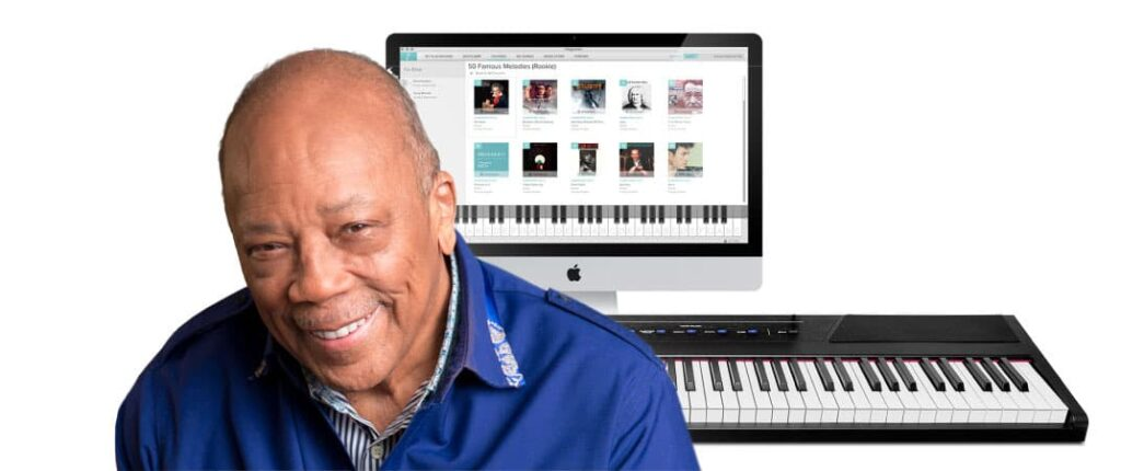 quincy jones in front of his app and a keyboard