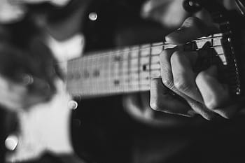 black and white guitar player